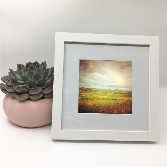 WideBrownLand-framed-wall-art-photography-art-white-frame-situ